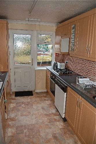 View of galley kitchen in traditional style.