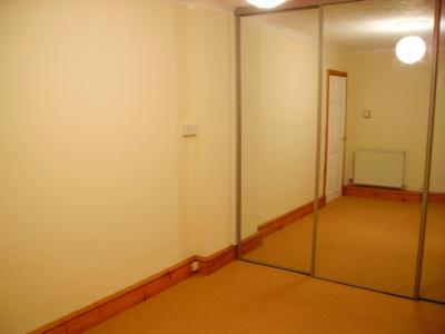 Master Bedroom with Mirrror Fronted Built in Wardrobe