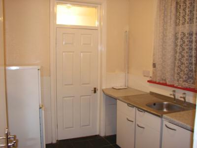Kitchen showing Fridge freezer and Door to Entrance Hall
