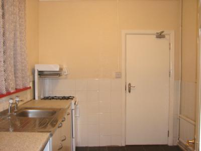 Kitchen with Gas Cooker and Door to Hall
