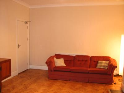 Lounge with large sofa and Floor standing Light